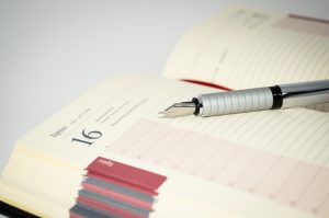 Page to a Day Diary open with a Fountain Pen sitting on a page. Manage your time effectively.