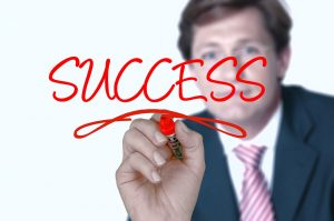 Man writing success on window. MBTI Leadership Success