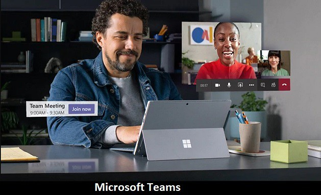 Man working on Surface Pro Laptop having a conversation Microsoft Teams