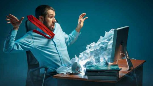 Man being overwhelmed with emails flowing out of his computer Learn some effective email communication strategies